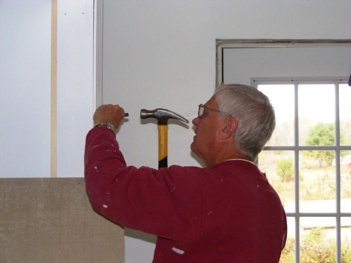 Volunteer, Del, setting nails.